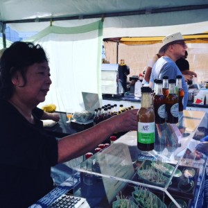 Kei flogs the dressings, at our last market stall